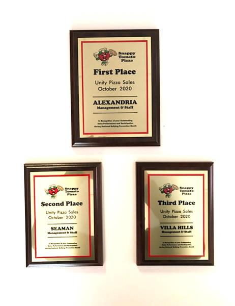 """Award Plaques – First Place Alexandria, Kentucky's Snappy Tomato Pizza  """"Add Cheddar and Make It Better"""" - Snappy Tomato Pizza raised $5,818.  We added cheddar cheese to represent the color of Unity Day and each $1 was donated to PACER's National Bullying Prevention Center.   First Place – Alexandria, Kentucky   Second Place – Seaman, Ohio   Third place – Villa Hills, Kentucky. Visit SnappyTomato.com/UnityPizza for more information.  #SnappyTomato"""