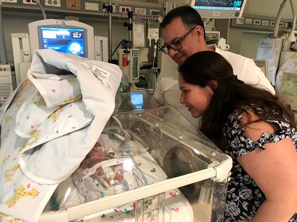 Siddhartha Rodriguez and Jesus Romero visit baby Amanda in the NICU at The Woman's Hospital of Texas.