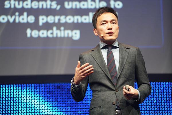 Derek Li giving speech during the summit