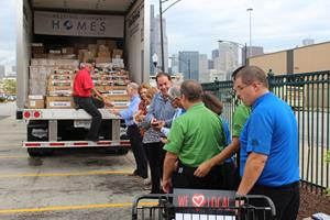 Representatives passed a portion of Smithfield's Helping Hungry Homes donation.JPG