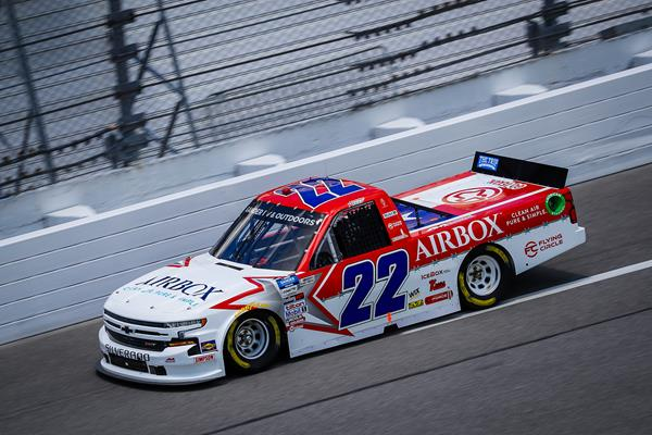Austin Wayne Self, driver of the AM Racing #22 of the NASCAR Gander Outdoor Truck Series, navigates through the 'dirty air' at Daytona International Speedway's road course race in August 2020. Photo Credential: Daylon Barr