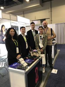 Several Dogness staff members pose at the Dogness booth at CES 2018