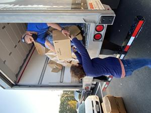 Sherri Barnett, manager of Christian Appalachian Project's Grateful Bread Food Pantry, helps distribute food boxes in Rockcastle County, Kentucky.