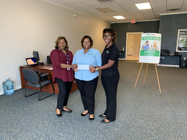 """""""Going the Extra Mile""""  The team from Minute Loan Center, Jackson, Mississippi donates $500 via their """"Going the Extra Mile"""" program to Big Brother, Big Sister of Mississippi.  From left to right in the photo: Shemika Moore, CSR at Minute Loan Center, Jackson, MS, Christine Jenkins, Manager Minute Loan Center, Jackson, MS and April Banks, BBBSMS State Program Manager.   https://www.minuteloancenter.com/locations/?id=jackson-2"""