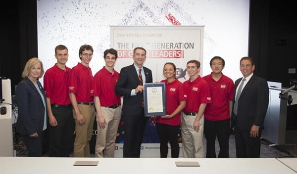 Governor Ralph Northam (D-VA) and Virginia State Delegate Kathleen Murphy (far left) offers a proclamation that recognizes the University of Virginia team's victory in the National Collegiate Cyber Defense Competition.