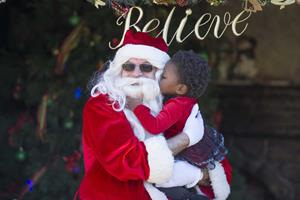 Child meets Santa at Clearwater's Winter Wonderland
