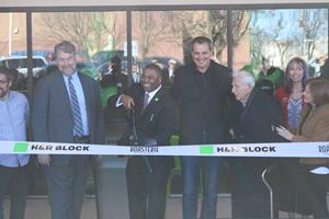 H&R Block and The Roasterie Café celebrate their collaboration on Main Street with a ribbon cutting ceremony November 30, 2017.