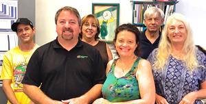 Bob and Teresa Stone (front and center) are second-generation owners of the Minuteman Press design, marketing, and printing franchise in Sarasota, FL.