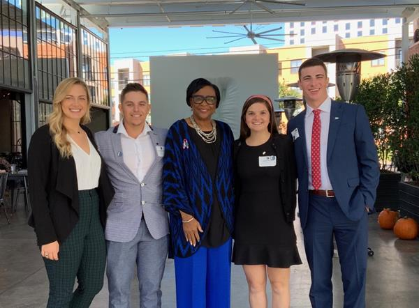 High Point University students (left to right) Sylvanna Schiefele, Chris Apecechea, Grace George and Parker Murphy spent the day shadowing Dallas Mavericks CEO Cynt Marshall (center).