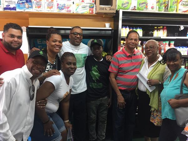 Members of Richard Allen New Generation (RANG), a community nonprofit organization which was recently designated as a Registered Community Organization (RCO) by the Philadelphia City Planning Commission, have partnered with Polo Supermarket, located at 10th and Brown Streets, to have the store hire Shareem Thorpe (sixth from left), a rising freshman at Benjamin Franklin High School, as part of a community agreement put in place in late April. Pictured here are Anthony Jimenez (far left), owner, Polo Supermarket; Anita Boyd (third form left), vice president, RANG; Bernard Gorham (fifth from left), president, RANG; and other officers and members of RANG's board.