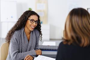 1_int_African_American_Female_Talking_Caucasian_Female_Mentoring_Planning.jpg