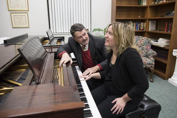 Dr. Chuck Clevenger teaches Macy McClain how to play the piano during the Fall 2017 semester at Cedarville University. Photo by Scott Huck