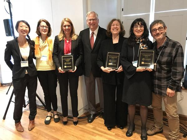 The winners of the Innovation@Home age-friendly housing contest are acknowledged at the 2018 International Technical Meeting on Ageing at Home, in Québec City, Canada, October 22, 2018. The contest was co-sponsored by Grantmakers In Aging (GIA) and the World Health Organization's Global Network for Age-Friendly Cities and Communities. (L. to R.: Diane Wu, WHO Department of Ageing and Life Course; Jenny Campbell, GIA consultant; Raquel Castelo Branco, Aconchego Program, Porto, Portugal; John Feather, CEO, Grantmakers In Aging (GIA); Sybil Boutilier, Chair, Age Friendly Sausalito; Yolanda Moragues Casabon and Joan Vidal, Home Refurbishment Program in the Barcelona Province, Spain.)