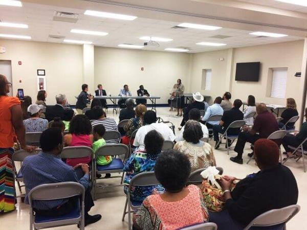 Residents of the Concerned Citizens of Richmond County speak at a community forum in opposition to a proposed Enviva wood pellet mill. Dobbins Heights where the facility is set to be built is designated as an Environmental Justice community.