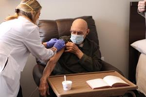 Raymond Gano, a resident at Eclipse Senior Living's Elmcroft of Martinsburg community, receives his vaccination.