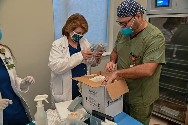 Madeline Camejo, Chief Pharmacy Officer at Baptist Health, unpacks first COVID-19 vaccines