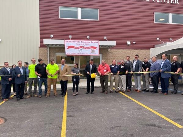 Carpenters taking part in Ribbon Cutting of the Duncansville Training Center