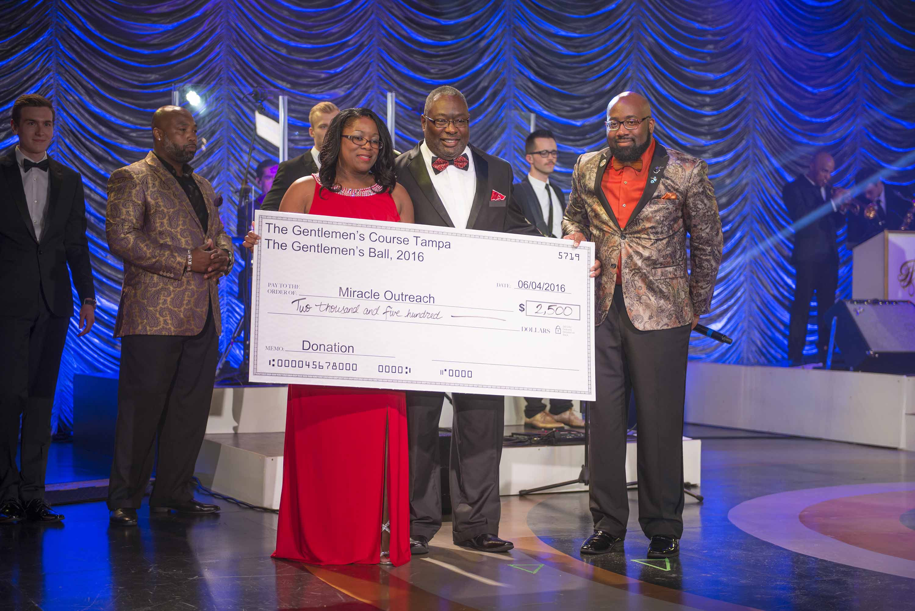Presentation of donation at June 4th Gentlemen's Ball.jpg