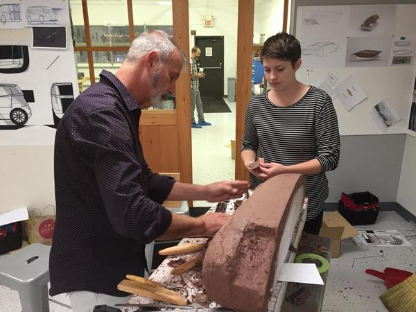 Don Grzebienik, clay sculptor for General Motors, works with Kadi Richardson from Cedarville University's Industrial and Innovative Design program. Cedarville's program is ranked No. 5 nationally according to CollegeValuesOnline.com.