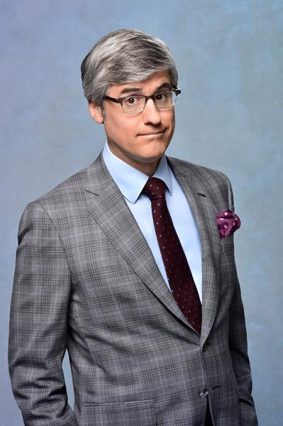 """Mo Rocca of CBS's The Henry Ford's Innovation Nation headlines the Connecticut Science Center's Virtual Gala with Kari Byron of Mythbusters and singer/songwriter Jill Sobule, best known for the hit """"Supermodel"""" from the soundtrack of the 1995 film Clueless, will also debut the song """"Love Science""""."""