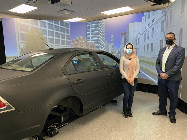 LSU Civil Engineering Assistant Professor Hany Hassan (right) conducts research in the college's driving simulator as part of his study into senior citizens' driving behavior in various traffic and environmental conditions.