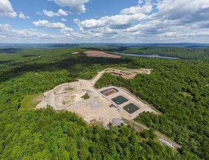 Aerial view of Nouveau Monde's demonstration site at the forefront and the zone for the Matawinie mine industrial platform at the back, now ready for the start of civil works.