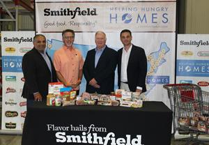 Jonathan Huhn joined representatives from HEB, San Antonio Food Bank and Smithfield.JPG