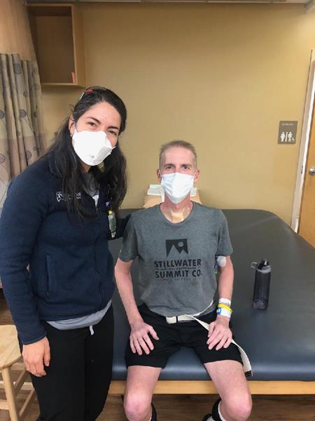 Oklahoma Fire Captain Randy Blake with lung transplant Norton Thoracic Institute pulmonologist, Sofya Tokman, MD, during a therapy session in the Barrow Neuro Rehabilitation unit at Dignity Health St. Joseph's Hospital and Medical Center in Phoenix. Blake survived COVID-19 but suffered irreversible lung damage and needed a lifesaving lung transplant.