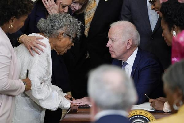Ms. Opal Lee at The White House embraced by President Joe Biden and Vice President Kamala Harris [Credit: Associated Press]