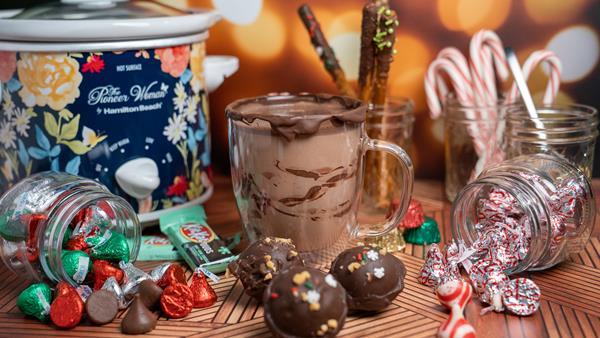 Get the recipe for hot cocoa bombs filled with holiday candy in the video description.