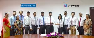 Commercial Bank Assistant General Manager – IT Krishan Gamage exchanging agreements with Duo World Inc. CFO/ Director Jennifer Samuel Perera
