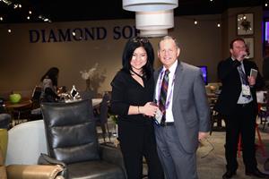 Tawny Lam with Irv Blumkin, CEO of Nebraska Furniture Mart