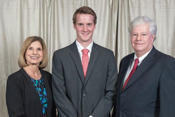 Dave and Phyllis Graurer stand with a Cedarville University pharmacy student during an awards program.