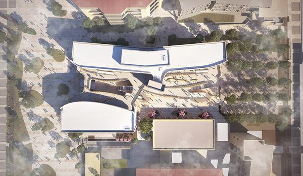 Aerial rendering of the new Classroom Building at the University of California Santa Barbara currently under construction. The project comprises two main volumes surrounding a central circulation corridor that runs east-west, linking the extension of Library Mall to Science Walk. This open-air paseo interconnects the functions of the building, providing outdoor terraces, stairs, bridges, and collaboration spaces designed to encourage serendipitous interactions and collaboration among students and faculty. Image: © LMN Architects.