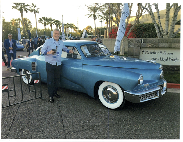 Stephen Tebo poses with the Tucker 48, commonly referred to as the Tucker Torpedo. The vehicle is one of only 47 in existence and on display at Tebo's