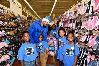 Magic player Khem Birch with youth from Boys and Girls Clubs.