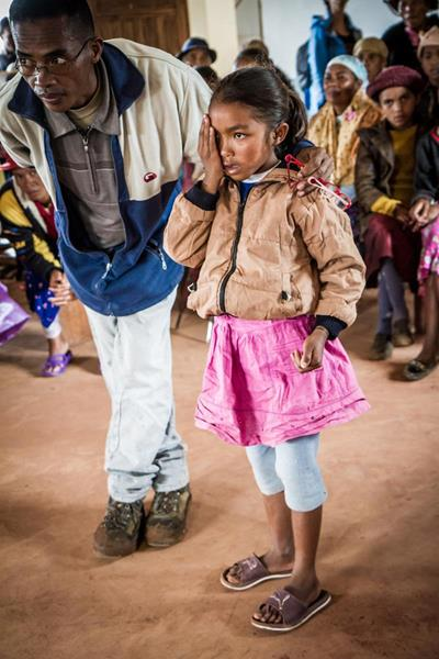 Malagasy girl getting a visual acuity test during an outreach screening in her village.
