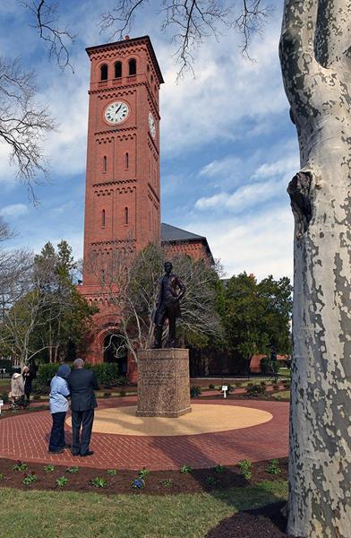 Visitors view statue of Hampton University founder, Brigadier General Samuel Chapman Armstrong