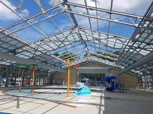 Openaire creates unique indoor outdoor pool design for for Pool design center
