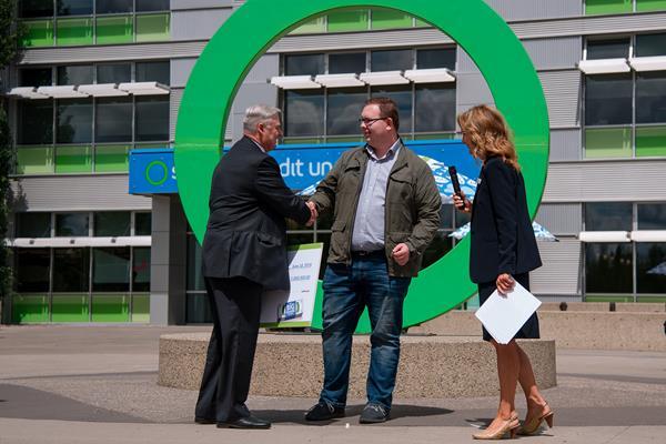 Garth Warner - CEO of Servus Credit Union - Congratulating Andrew Buchner the million dollar winner of the Big Share contest