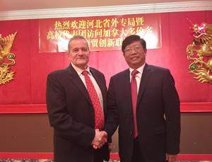 Mr. Wang Zhongqun, Director General, Hebei Bureau of Foreign Experts Affairs and Dr. Gene Shelp, CEO, CWTI