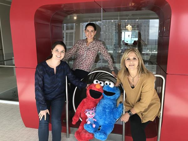 The Kids II Strategic Partnership team with some of the Sesame Street characters who inspired the newest Bright Starts line coming in 2019. LtoR: Jaime Martin, Eriana Rivera-Rozo and Karen Neblett