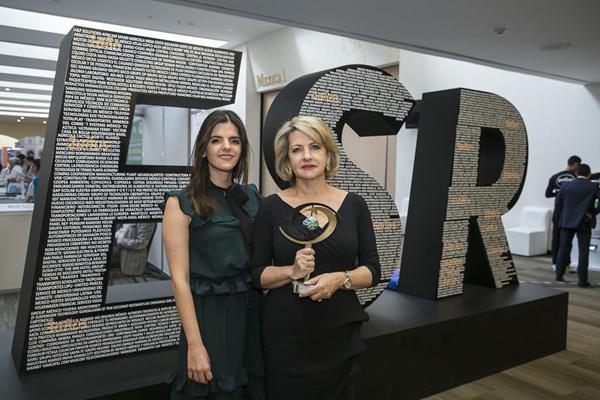 Marianne and Marlene Kafie received the award on behalf of Lacthosa