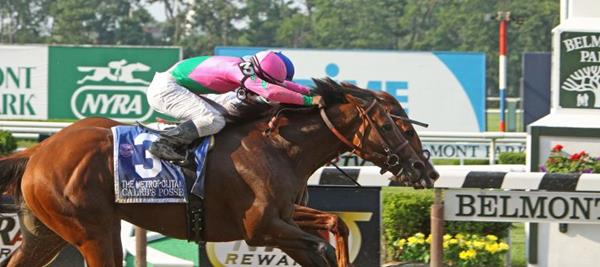 """ELMONT, NY: John Velazquez and """"Shackleford"""" (against the rail) nose out Rajiv Maragh and """"Caleb's Posse"""" to win The Metropolitan Handicap at Belmont Race Track on May 28, 2012, in Elmont, NY.  Photo credit: Shutterstock royalty-free stock photo ID:103796159 By Cheryl Ann Quigley"""