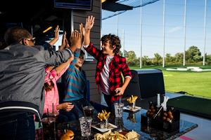 Topgolf inspires people of all ages and skill levels – even non-golfers – to come together for playful competition.