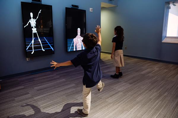 Young visitors enjoy Body Worlds Decoded at The Tech Interactive. The exhibition is the only experience in the world combining real human plastinanates with a custom Augmented Reality experience and other immersive technology for an in-depth look at how the body works.