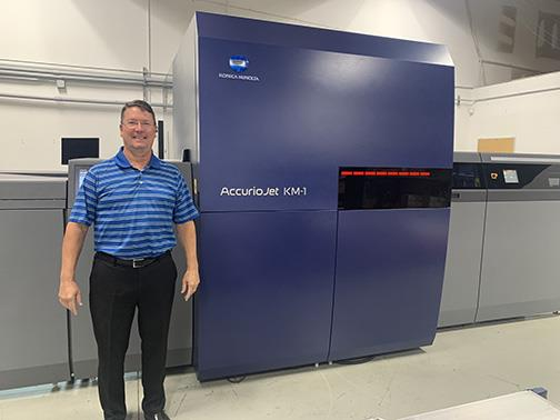 Pat McBride, Owner, Envision Printing, with its newly installed Konica Minolta AccurioJet KM-1 LED UV Inkjet Press