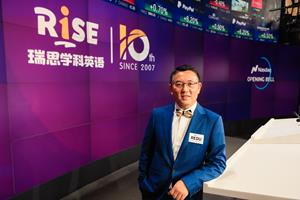 Yiding Sun, Chief Executive Officer, RISE Education, rings the Nasdaq Stock Market Opening Bell
