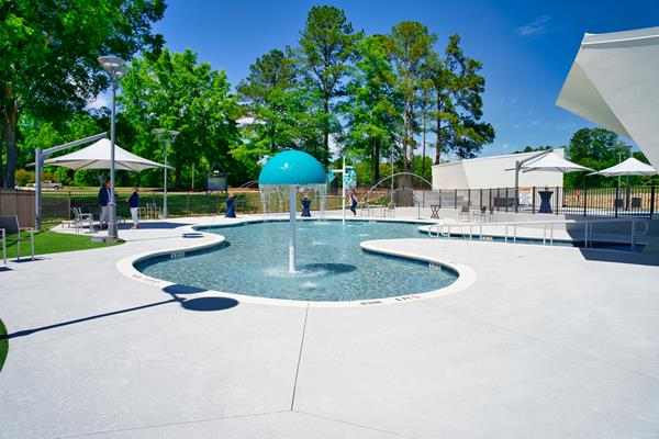 Summer campers and veterans alike will enjoy the beauty and tranquility of the Aquatics Center's spacious deck and zero-entry pools.