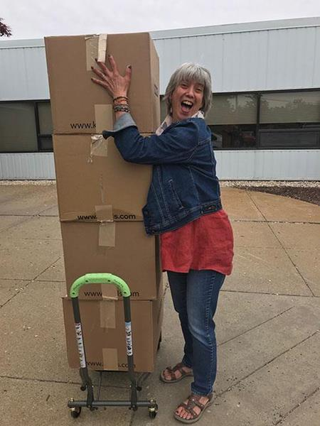 Sheree DiMario, Development Department, Volunteer Coordinator at Columbus House picks up the 25 donated appliances at Watson Inc.